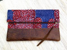 Red White and Blue African Clutch with Distressed by elHustle, $132.00..very cute but I need to learn how to sew so I can make for 1/2 the price! I have the fabric!
