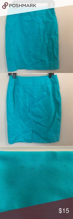 Turquoise pencil skirt with pockets The classic pencil skirt gets updated in a spring ready turquoise. Excellent condition but there are three small stains (third photo) on waistband, only visible up close. Has been washed but spot treatment may work Halogen Skirts