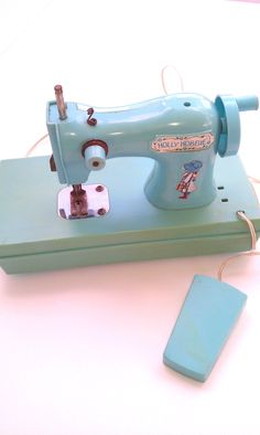 Hollie Hobbie Sewing Machine - Vintage Toy in Turquoise from 1976. $15.00, via Etsy.