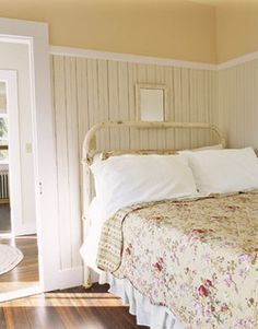 Soft, warm colours like this buttery yellow, mixed with soft floral bedding, antique-looking furnishings, and soft, sweet patterns like this wallpaper in the same natural colours, is a great way to subtly bring that down-home country feel into a room. #bedroom #country