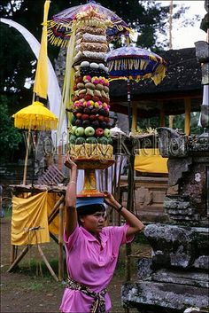 Indonesia, bali, small temple, ceremony, woman bringing offering