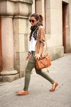 Green skinnies, white t, neutral cardigan, and cognac leather accessories.