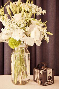 Simple, elegant centerpiece idea with mason jars + vintage cameras.