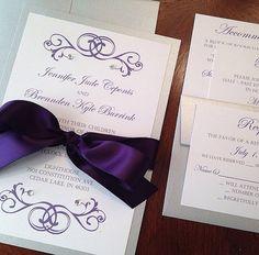 Enclosed is a *SAMPLE* Non- Pocketfold Wedding Invitation with an elegant flourish accent design and non-Swarovski crystals. The invitation has a