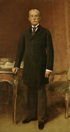 Portraits of Henry Flagler, painted in 1899 by society painter, Raimundo de Madrazo y Garreta, Flagler's portrait depicts him with the heel of his right hand resting on a Louis XV table with an open ledger book and stack of literary books behind. Henry Morrison Flagler Museum (Palm Beach, Florida)