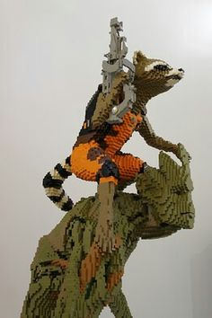 """Check Out This Huge Lego Model of Groot and Rocket Raccoon.""""I am Groot"""". Groot was my favorite character Lego Disney, Lego Marvel, Lego Batman, Marvel Avengers, Marvel Comics, Instructions Lego, Films Marvel, Lego Sculptures, Amazing Lego Creations"""