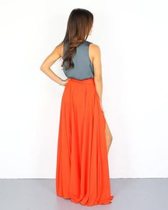 What a gorgeous full bodied maxi skirt in sunset orange! Our Sunshine Soul Maxi Skirt is beautiful with flow and movement in this floor length silhouette. The front slit makes this piece breathable an