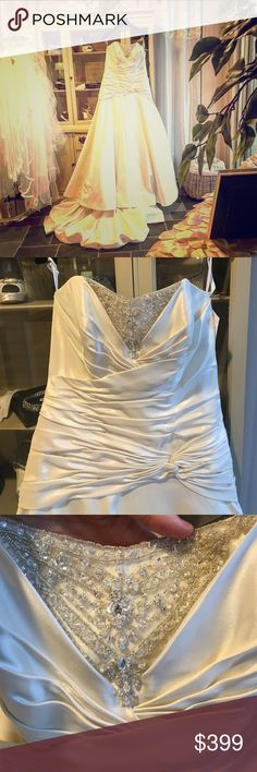 """Bridal gown Beautiful strapless drop waist Bridal Gown (for come with straps if you'd like them) ~ ivory in color with beautiful silver and crystal detailed beading. Fanned train. This dress has been tried on a few times in our boutique but is in pretty good condition. No noticeable signs a wear. Please refer to the sizing charts provided under the """"Meet your Posher"""" listing for best fit. Dresses Wedding"""