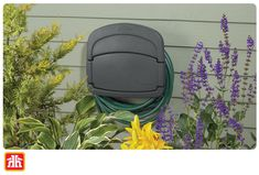 Conveniently store gardening and watering accessories within this resin hose hanger.