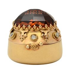 Gold Box with Citrine and Diamonds, Wonderfully detailed gold pillbox with a huge dark citrine top and diamonds surrounding the gold. Tests 18 karat. From the estate of the late actress, Merle Oberon (1911 - 1979). circa 1950's. #vintage #box