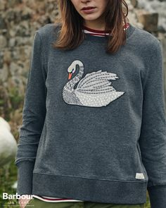The Barbour Cabin Sweatshirt is a pure-cotton design featuring the collection's swan motif in appliqué and embroidery at the chest. A deep hem and cuffs add contemporary appeal to this easy-to-wear layer.