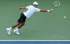 ;MASON, OH - AUGUST 17:  Novak Djokovic of Serbia htis a backhand against Marin Cilic of Croatia during day seven of the Western & Southern Open at Lindner Family Tennis Center on August 17, 2012 in Mason, Ohio.  (Photo by Nick Laham/Getty Images)