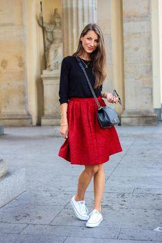 Black sweatshirt, pleated tea-length red skirt + cool Converse sneakers | Street Style: 25 Cool Sweatshirt Outfit Ideas