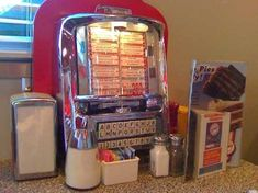 A tabletop jukebox at the 5 & Diner. -- Oh I SO loved and miss these!