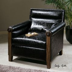Uttermost Ormond Armchair. The quintessential club chair modernized with sleek, horizontal channel tufting, squared off back and rolled arms with metal bull's-eye detail. Breathable and cleanable, black faux leather with solid pine frame. Pillow included.