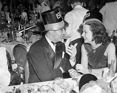 Charles Boyer and Hedy Lamarr celebrate the New Year of 1939.