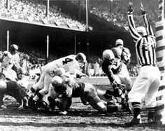 Lions quarterback, Tobin Rote, runs into the end zone for a touchdown in the Championship Game, December 29, 1957. (Detroit News archive)