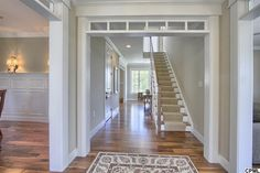 Traditional Hallway with Stark Carpet Runner Rug, Carpet, Hardwood floors, Crown molding
