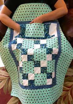 "Find handmade wheelchair lap quilts with pockets from Carolyn's Homesewn in NH. Our signature ""Lovie Lap Quilts"" feature pockets for extra warmth and storage. Click to shop today!"