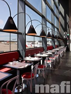 Cafe Vue, Melbourne International Airport featuring mafi Acacia Vulcano Brushed Natural Oil timber floors.