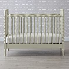 Shop Jenny Lind Grey Crib.  This cozy grey crib is adorned with intricate woodturnings, offering a timeless take on the classic Jenny Lind style.