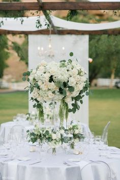 Under the Olive Trees ~ WedLuxe Magazine White Rose Centerpieces, Tall Wedding Centerpieces, Destination Wedding Inspiration, Tea Candles, E Magazine, Olive Tree, Topiary, White Roses, Elegant Wedding