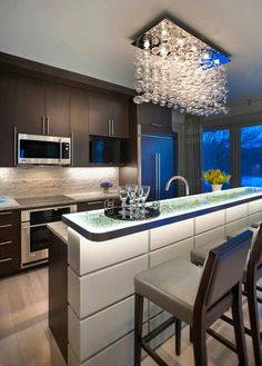 Kitchen Lighting Design for Easy Work and Stunning Decor: Epic Contemporary Kitchen Design Decorated With Modern Kitchen Lighting Design Used Crystal Chandelier Decoration Ideas For Inspiration ~ SFXit Design Kitchen Inspiration Home Decor Kitchen, Beautiful Kitchen Designs, Kitchen Decor Modern, Contemporary Kitchen, House Interior, Kitchen Island With Seating, Modern Kitchen Design, Kitchen Style, Kitchen Design