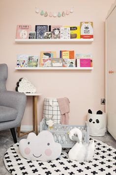 Toy storage for nursery | Panda Storage Bag | Cloud Cushion | Monochrome Rug | Swan Cushion | Book Shelves | A pastel and monochrome nursery for a little girl with details from The Modern Nursery | Photography by Emily Gray Photography