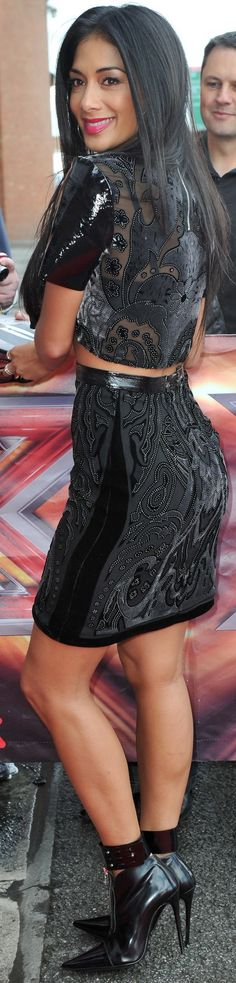 Nicole Scherzinger X factor auditions 2013 in Manchester, England Nicole flaunted her midsection in a Topshop Unique leather studded crop top and pencil skirt, zippered Etro ankle boots and Lara Bohinc jewelry.
