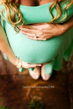 Other pinner: Pregnancy photo thats not so corny that I would maaaaybe consider. Me: um, cleavage and no face? Bump shot I'm on board for.