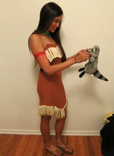 Finished DIY Disney Pocahontas costume. Necklace made with tiny glass beads and silver feather. Complete with Meeko, the raccoon sidekick, stuffed animal purse.
