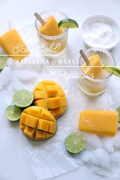Margarita & Mango Popsicles are a delicious frozen treat for those hot summer days! These homemade boozy popsicles are filled with fresh mangos and iced cold tequila!