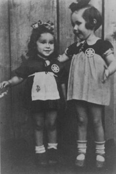 Two young cousins shortly before they were smuggled out of the Kovno ghetto. A Lithuanian family hid the children and both girls survived the war. Kovno, Lithuania, August 1943.