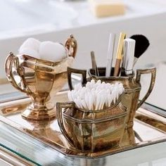 Isn't this so clever and pretty ! Using old silver tea set adds the perfect touch for powder room storage:)