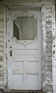 Storybook entrance.  Delicious French scrollwork makes the decay all the more decadent.  -- Eve.