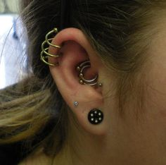 Triple helix with yellow titanium spiral, double daith with circular barbell and steel captive bead ring with titanium bead Crazy Piercings, Ear Piercings Tragus, Body Piercings, Piercing Tattoo, Peircings, Daith, Punk Jewelry, Ear Jewelry, Body Jewelry