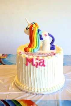 Check out this rainbow unicorn birthday cake!  See more party ideas at CatchMyParty.com!