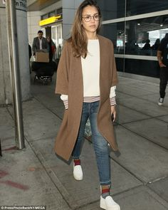 Jet-setter: The talented actress and entrepreneur was pictured touching down at New York's...