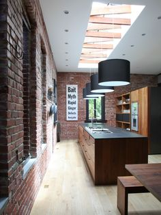 Elegant Open Kitchen with Natural Interior Lighting Systems: Wonderful Architectural Skylight With Perforated Wooden Beams Exposed And A Set Of Modern Pendant Lamps With Black Tube Shaped Shade