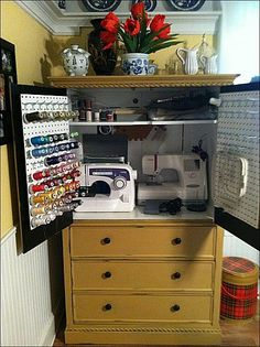 Armoire turned sewing cabinet  Wow IDea, colocar los palitos en peg board para los hilos