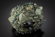 Stone Woven Cuff; A chunky, delicious statement cuff combining textures of rough cut stones and gems with wire wrapping and bead weaving.$360 http://www.juliepowelldesigns.com/product/wire-stones-cuff-seatangle/