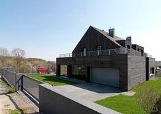 Dom w Burowie: Garaż zaprojektowany przez WIZJA