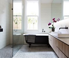 Diamonds are a Melbourne family's best friend in this sophisticated bathroom, stylishly underpinned by a graphic floor pattern.