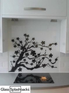 Black Lotus Tree Printed Glass Splashback. Design your own glass splashback! Our unique tool enables you to choose from a range of silhouettes. You'll choose your background and pattern colour from an enormous range of branded paints, creating a totally unique splashback!