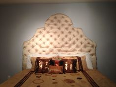"DIY king size headboard 5ft tall .... Made with 2 x 1/2 inch ply board .. Raw silk material and 3"" foam found at Walmart 2 bundle used 50$ each  .... We also used 81 Acrylic crystal stones bought from some Chinese website for 20$ total cost 200$"