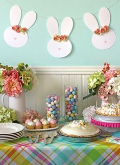 Easy Easter party decorating ideas. Love this pretty Easter dessert tablescape, the flowers, the fun Spring colors and that bunny garland! Free printable template and free cut file to make the floral crown Easter bunny garland.
