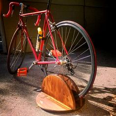 Homemade wooden bike stand with my bicycle on it.  (D.I.Y.)