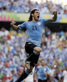Uruguay's Edinson Cavani celebrates after kicking a penalty shot to score his side's first goal during the group D World Cup soccer match between Uruguay and Costa Rica at the Arena Castelao in Fortaleza, Brazil, Saturday, June 14, 2014.   (AP Photo/Natacha Pisarenko)