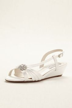 "The comfort and sophistication of these wedge sling back sandals prove they're a must-have staple for your evening look!  Wedge sling back sandal features a high-shine broach on the vamp and an adjustable strap with buckle to ensure the proper fit.  Heel height - 1"".  Satin upper and leather sole.  Imported."
