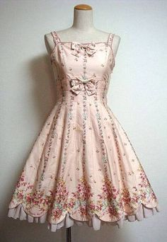 Fresh-as-springtime 1950s pale pink dress with scalloped hem and floral print